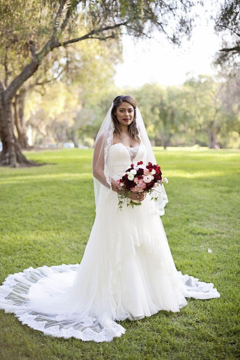 bride wearing romantic tulle wedding dress