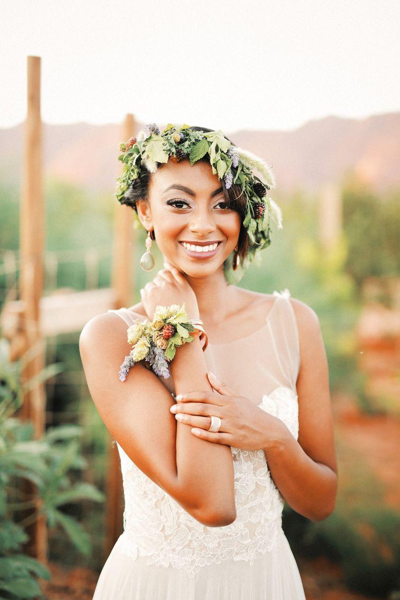 bride wearing greenery crown