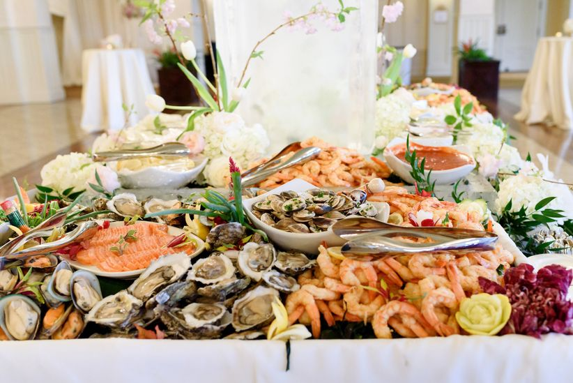These 16 wedding food station ideas will wow your guests weddingwire raw bar at a wedding junglespirit Image collections