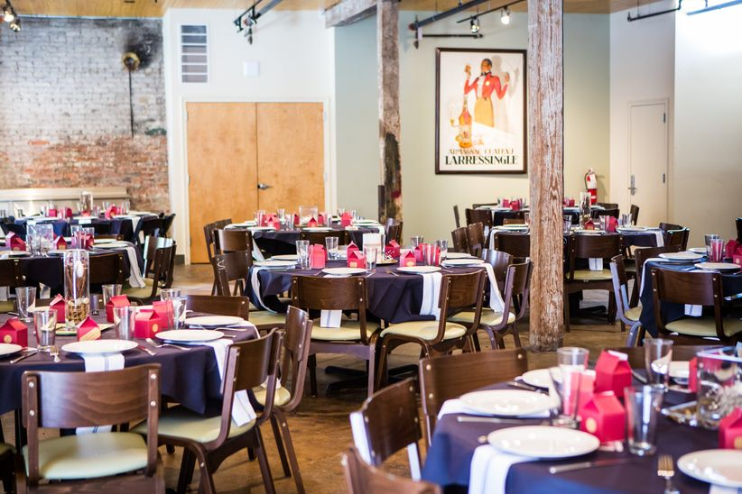 restaurant wedding reception with red and blue decor