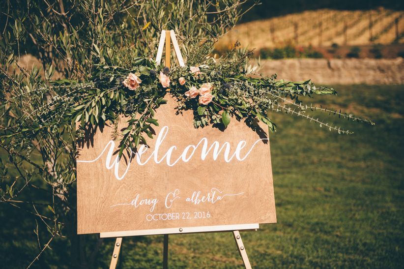 20 wedding day hacks every couple should know weddingwire wedding welcome sign with flowers junglespirit Images