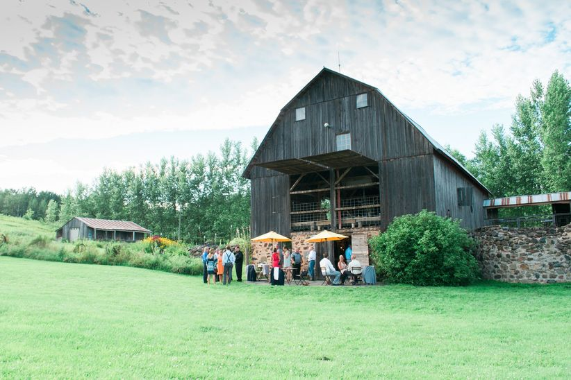 guests outside barn georgia rustic reception