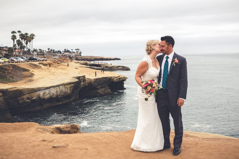 couple kissing on a beachy cliff in southern california
