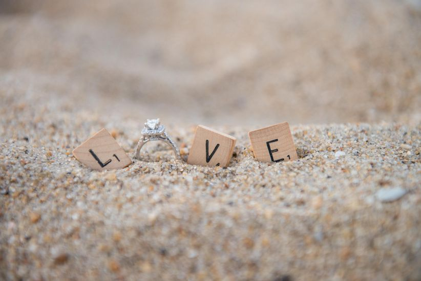 engagement ring stuck in the sand