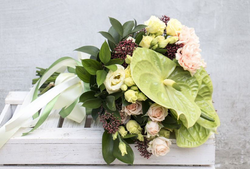 green anthurium bouquet with blush spray roses and ribbons