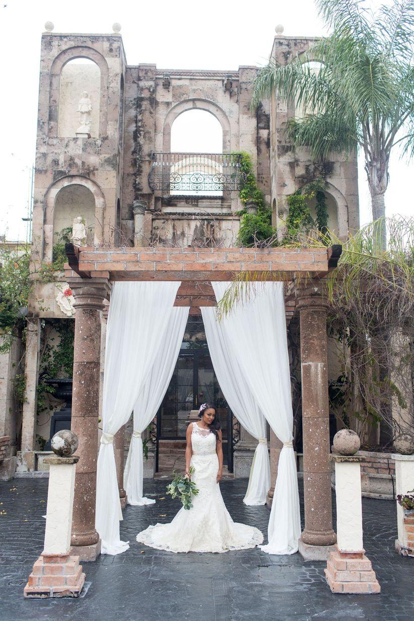 bride posing at a glam venue