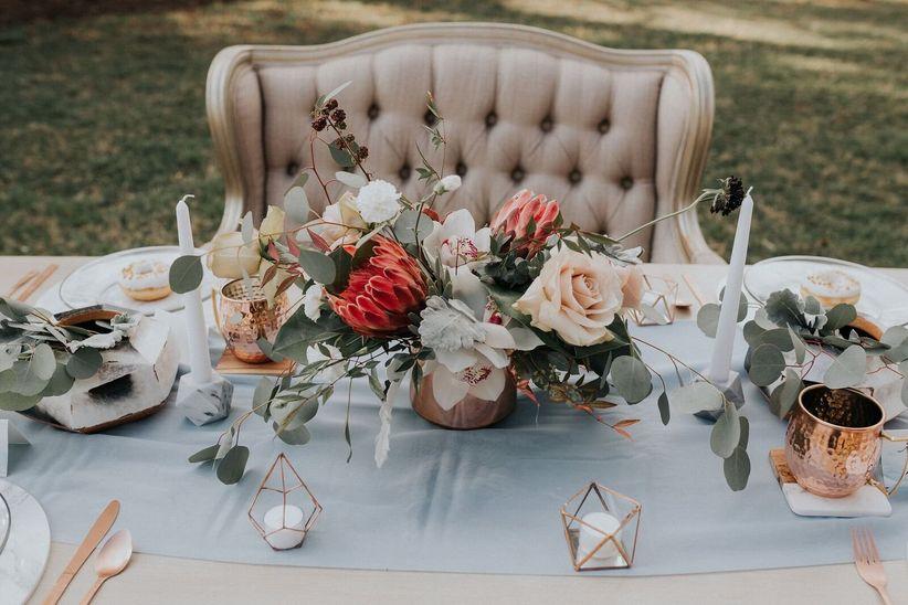 modern wedding centerpiece with greenery