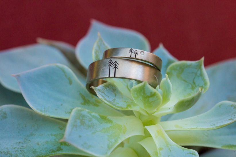 engagement ring displayed with succulent