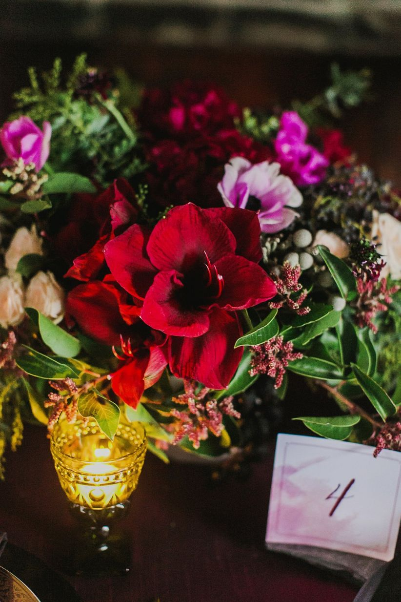 close up floral centerpiece and table number