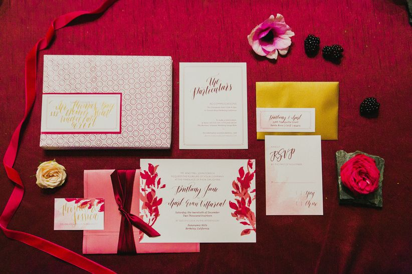 pink white and red invitation suite