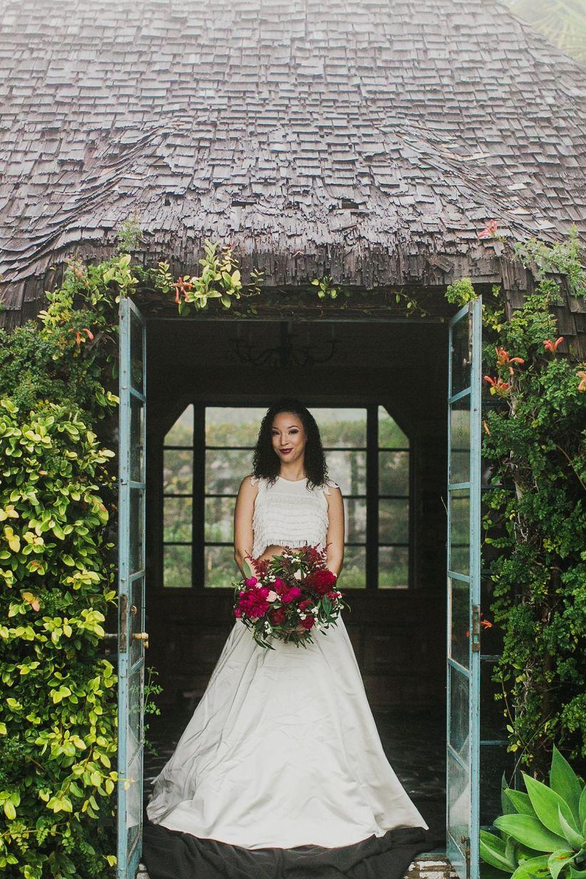 bride portrait bride standing in doorway holding loose bouquet