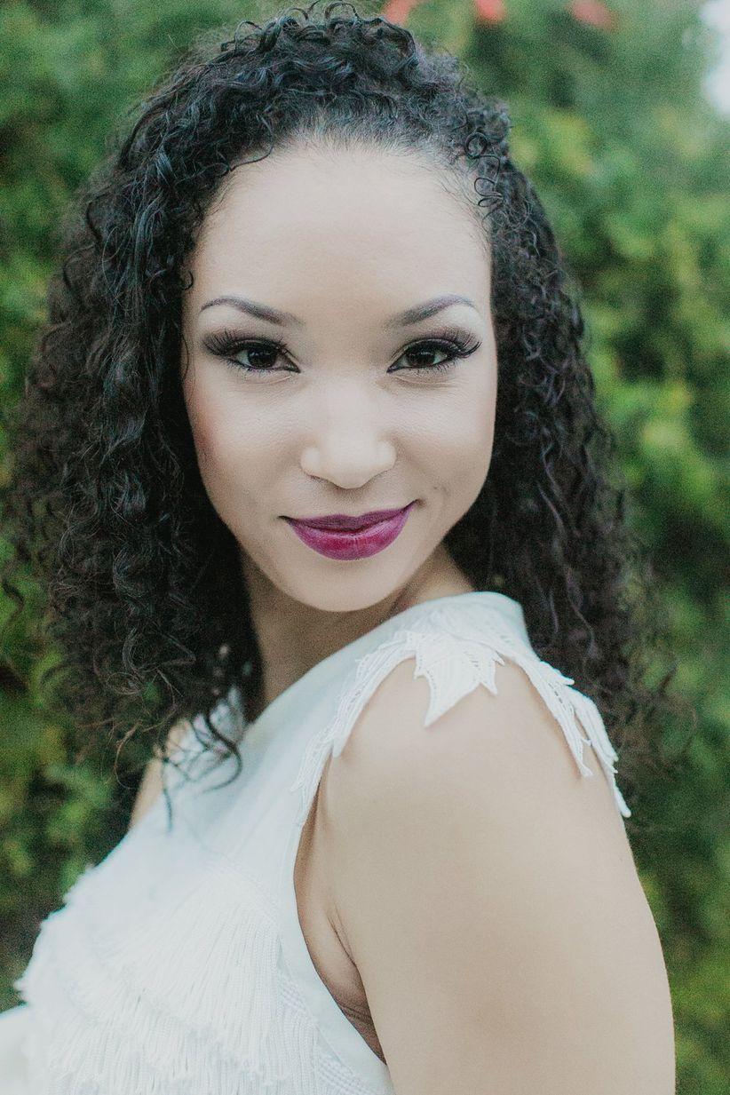 close up bride natural curls plum lipstick