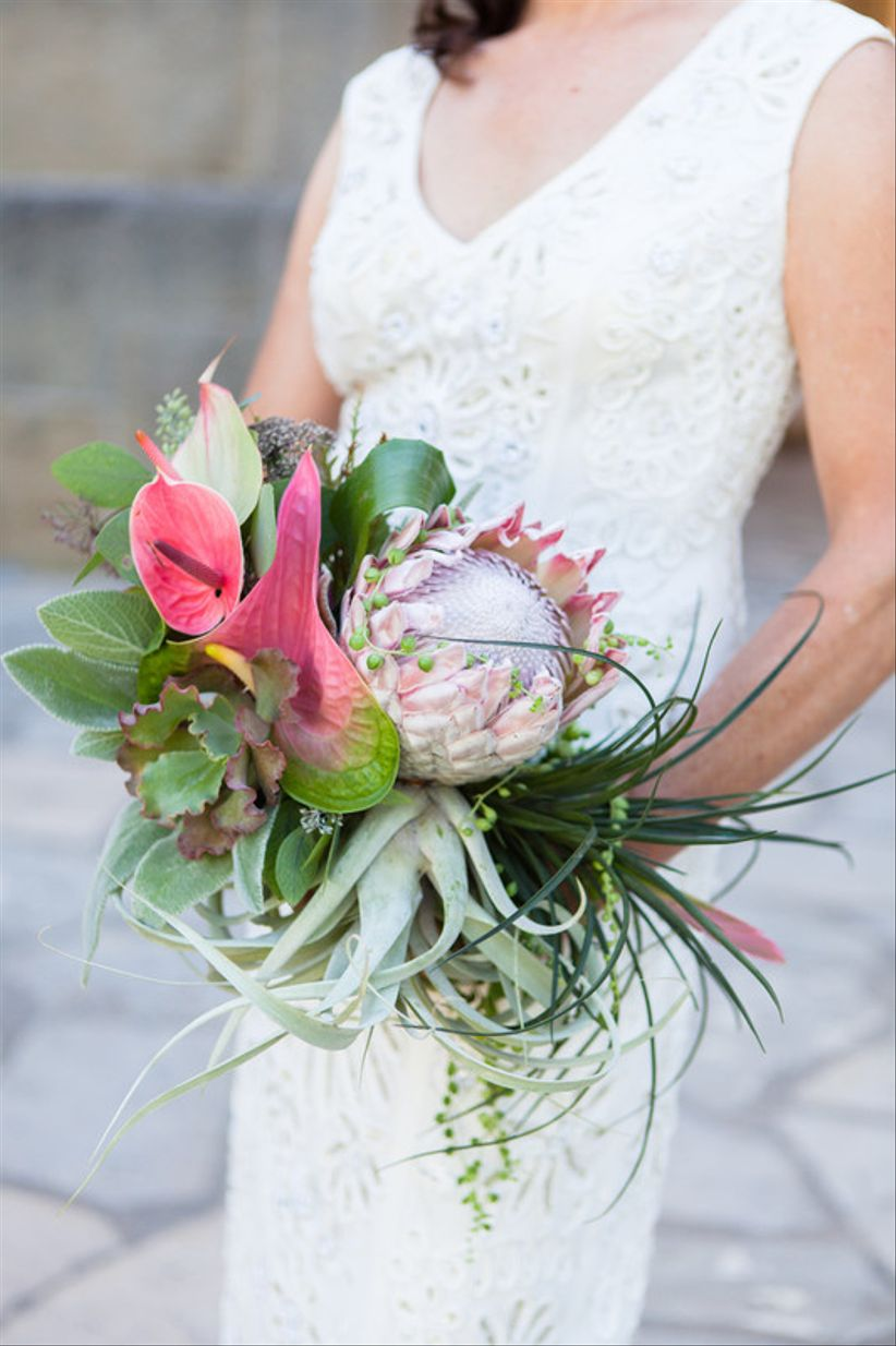 tropical beach wedding bouquet with anthurium and king protea