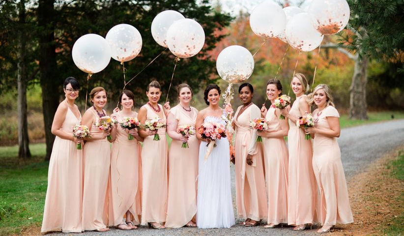 bridal party carrying balloons