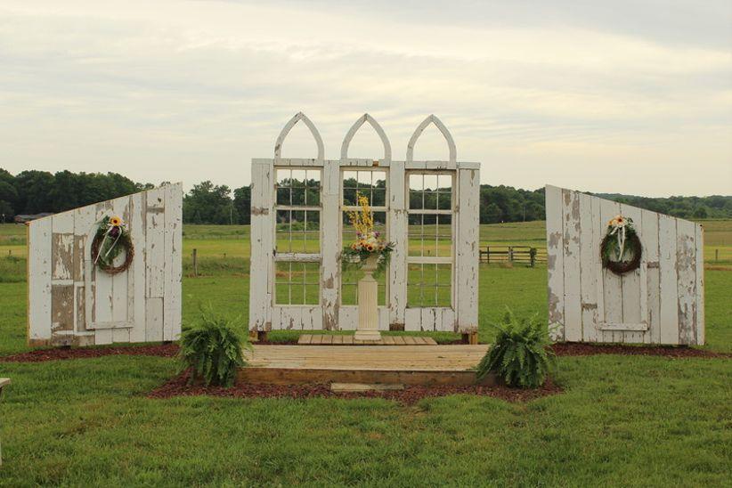 outdoor wedding chapel with barn doors and windows