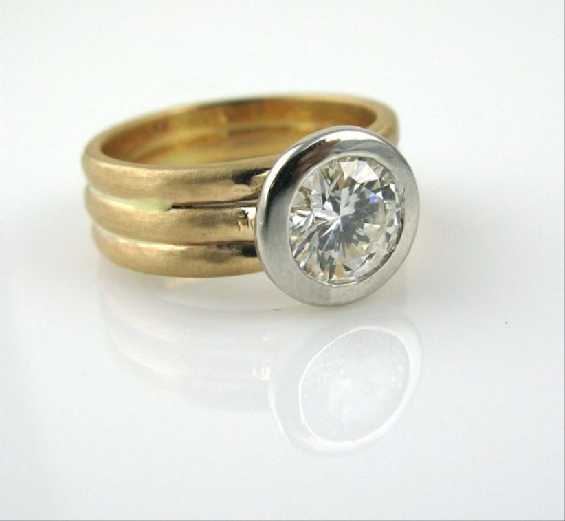 gold bezel set engagement ring with flat wedding band