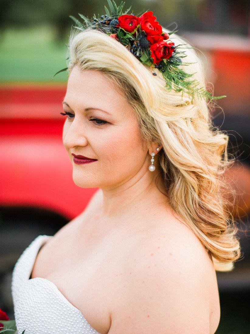 bride wearing a red rose floral crown