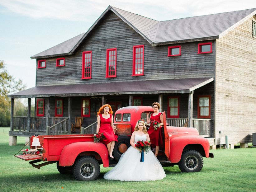 bride in front of red truck
