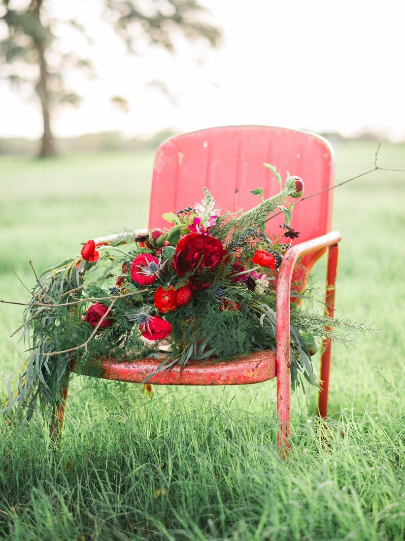 Red rustic chair with red bouquet