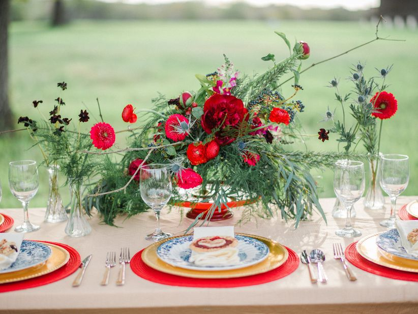 red floral and greenery centerpieces