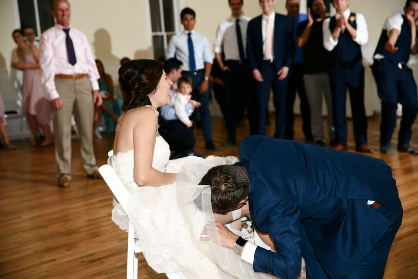 Image result for image, photo picture, throwing garter at wedding