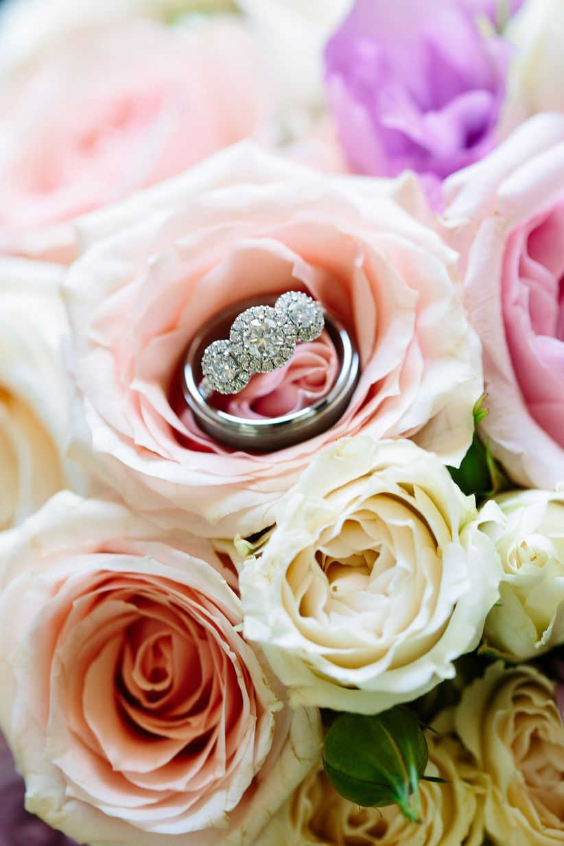 engagement ring displayed with roses