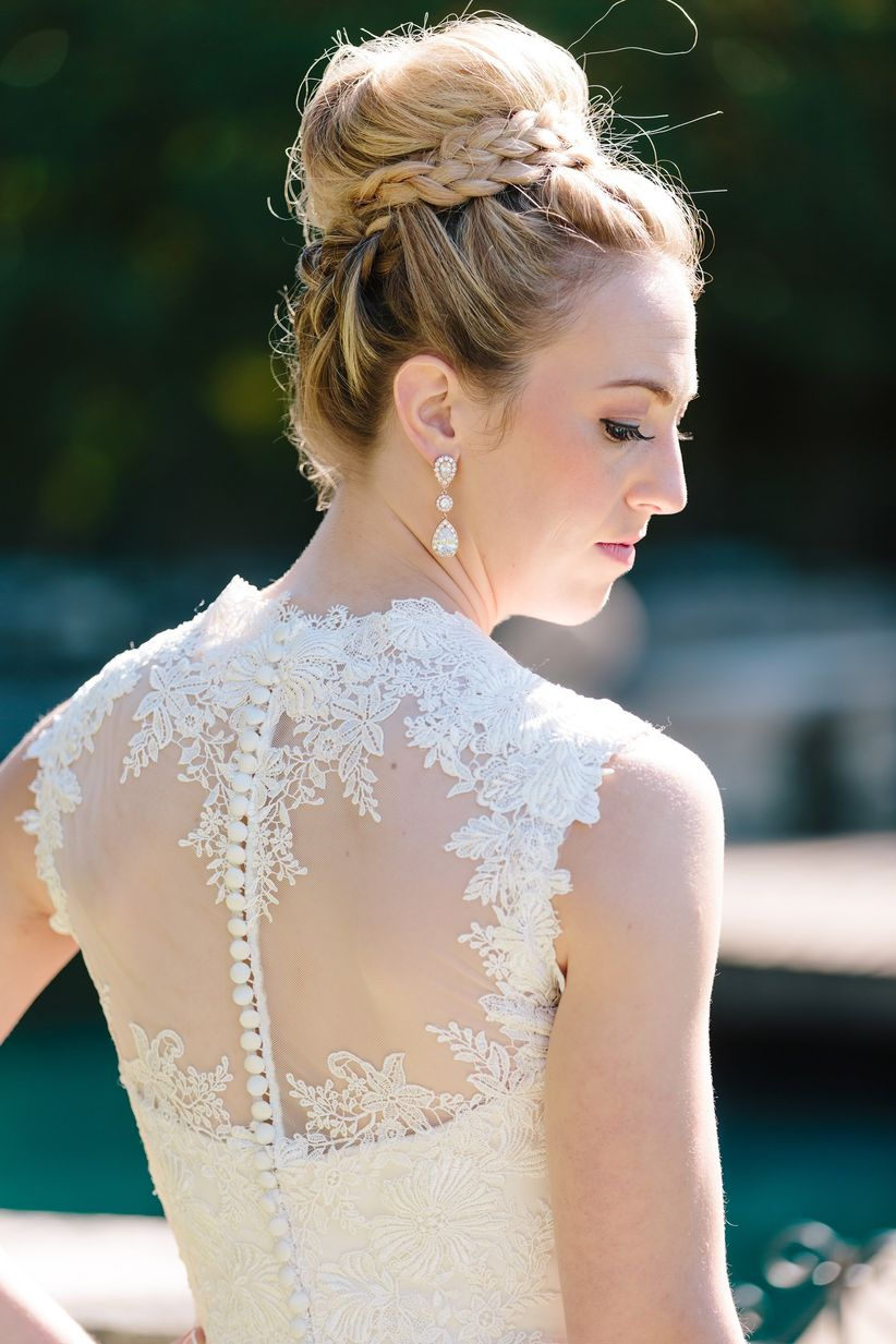 Bride in illusion back gown with braided top knot