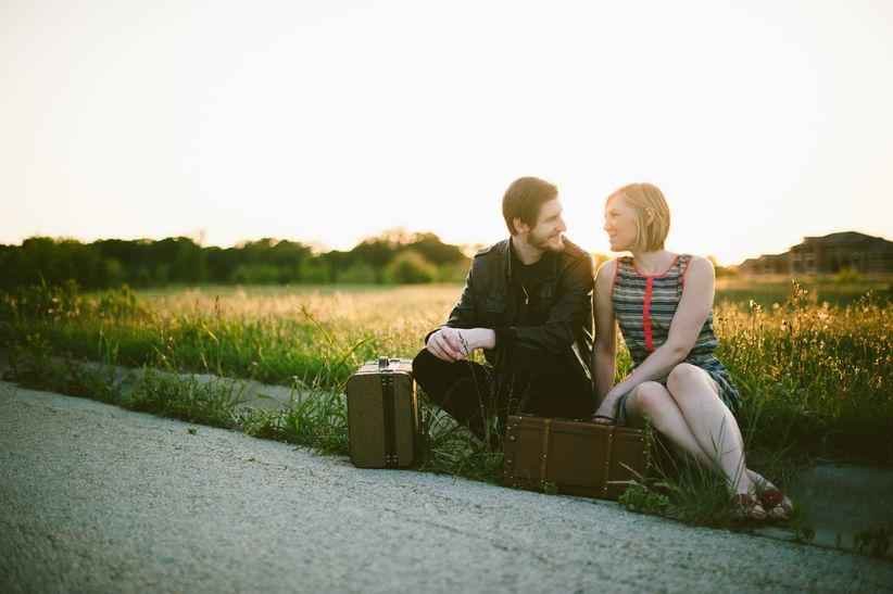 The honeymoon packing checklist every couple needs weddingwire couple with suitcases junglespirit Images