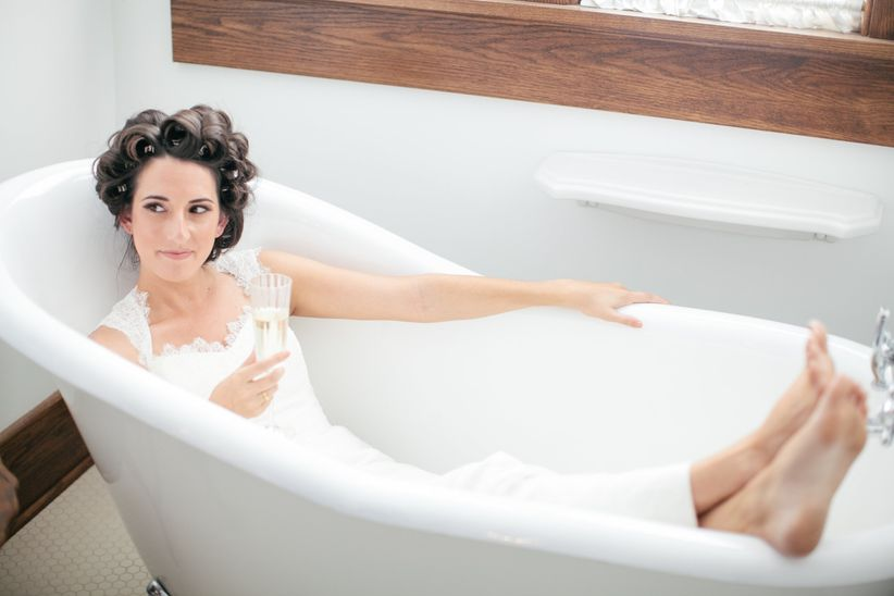 bride relaxing in bathtub