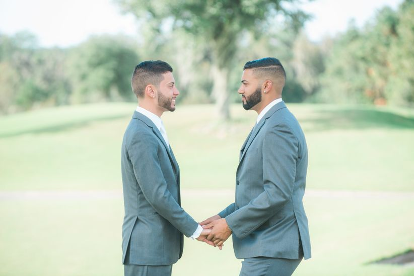 two grooms face each other