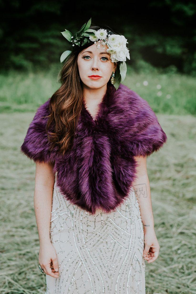 bride wearing purple faux fur wrap