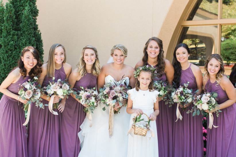 bride and bridesmaids wearing purple gowns