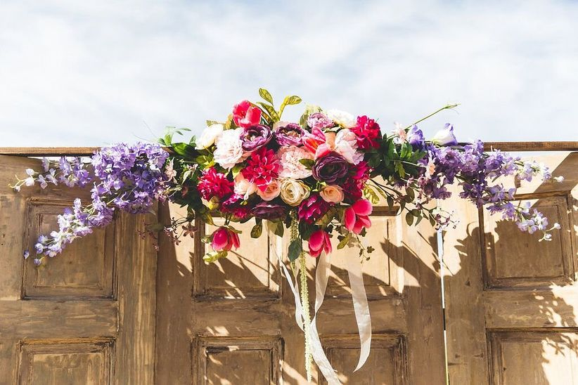 door backdrop with floral arch