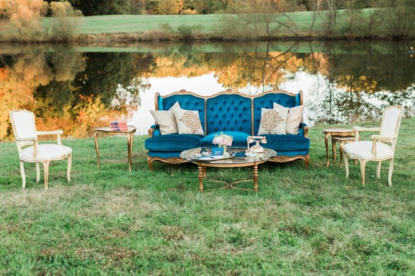 outdoor lounge space with vintage sofa armchairs and table