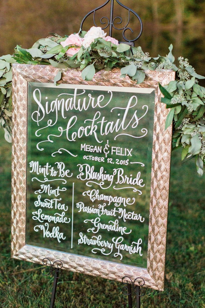 handwritten signature cocktail sign on golden framed repurposed mirror