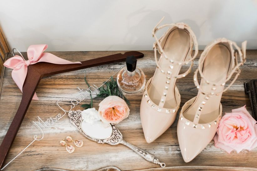 close up details of flowers personalized hanger nude studded heels