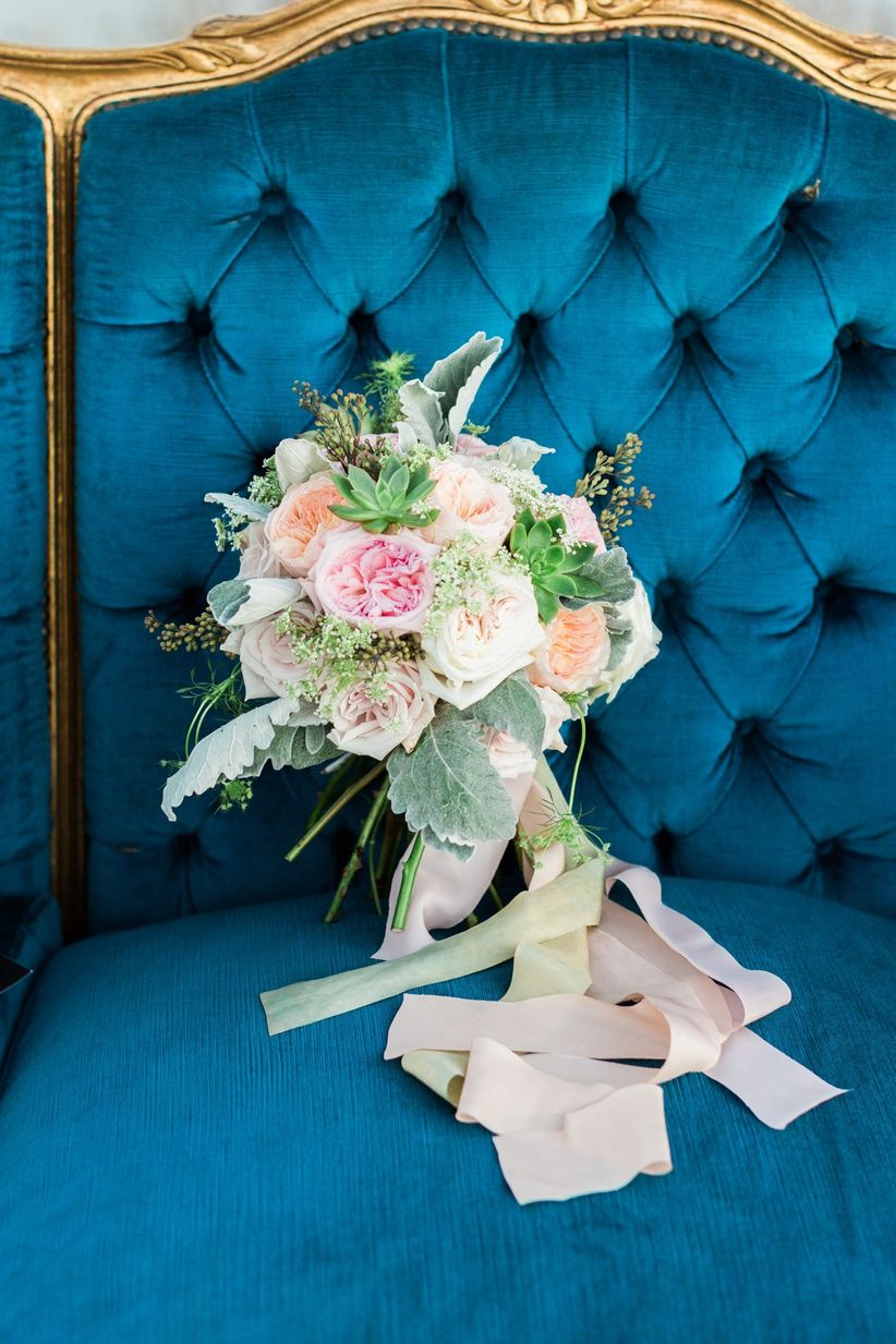 bridal bouquet on blue velvet lounge chair
