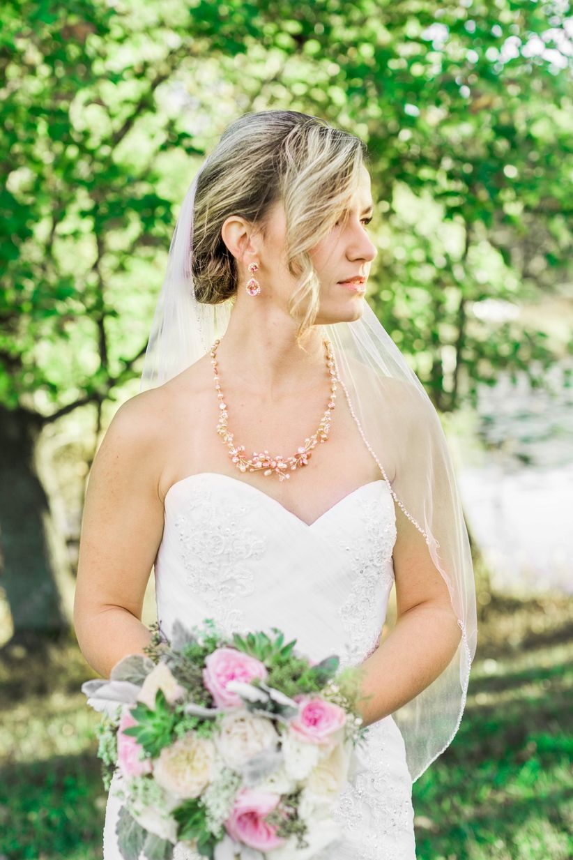 bride outdoor updo pearl necklace strapless gown lace details