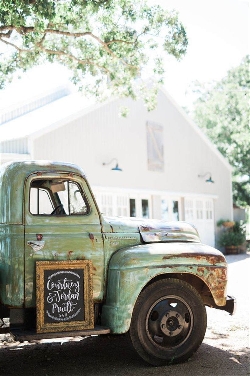 vintage pickup truck photo backdrop at rustic wedding venue