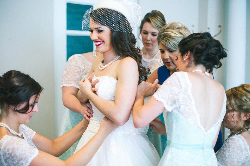 bride getting dressed vintage wedding dress krista lajara photography