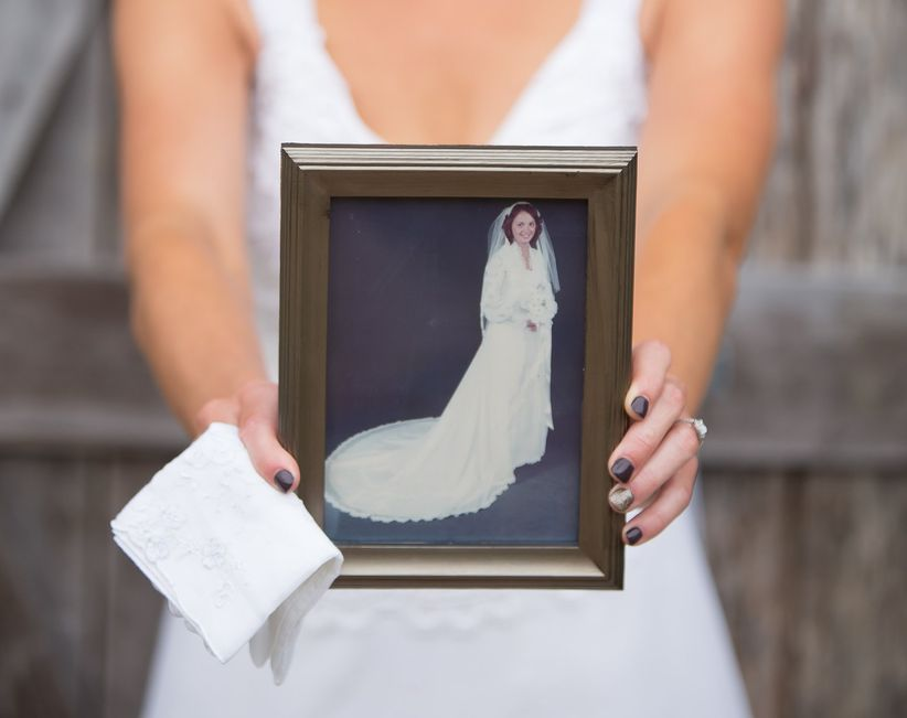 bride holding photo of mother