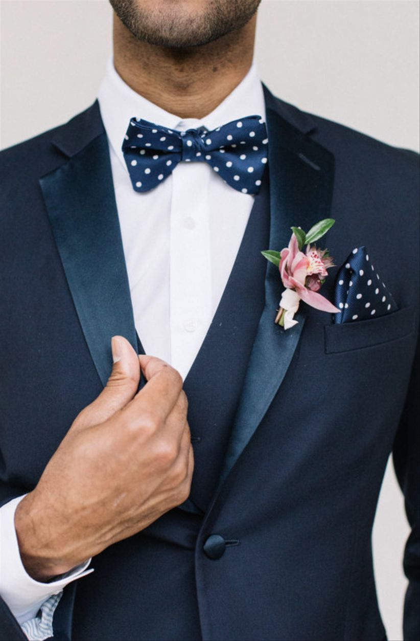 navy blue tuxedo with preppy polka dot bow tie and pocket square