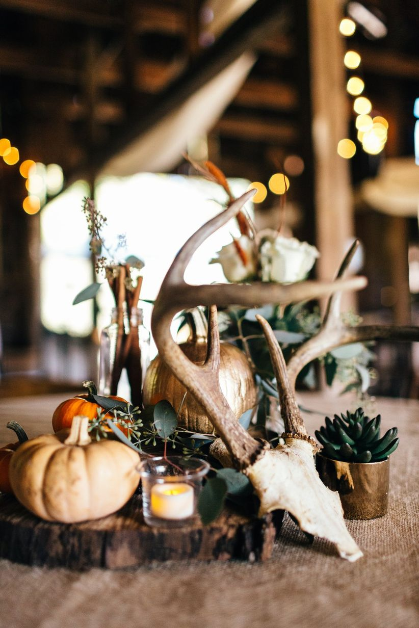 rustic wedding centerpiece with antlers, mini pumpkins and succulents