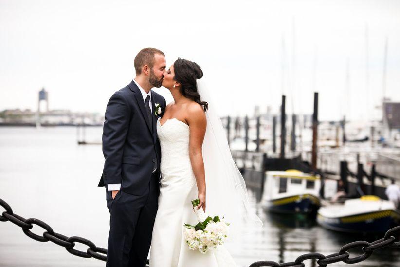 couple kissing near boston harbor