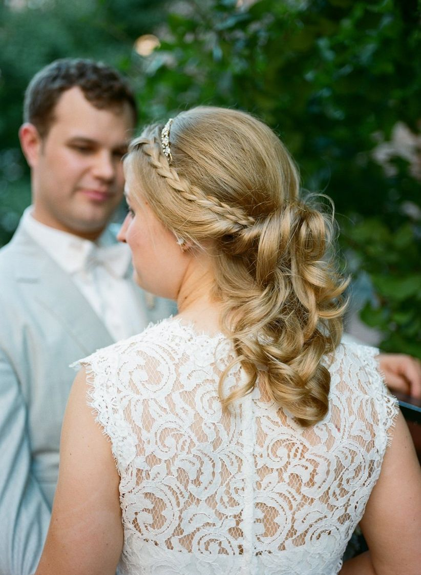 bride with curled ponytails with accent braids
