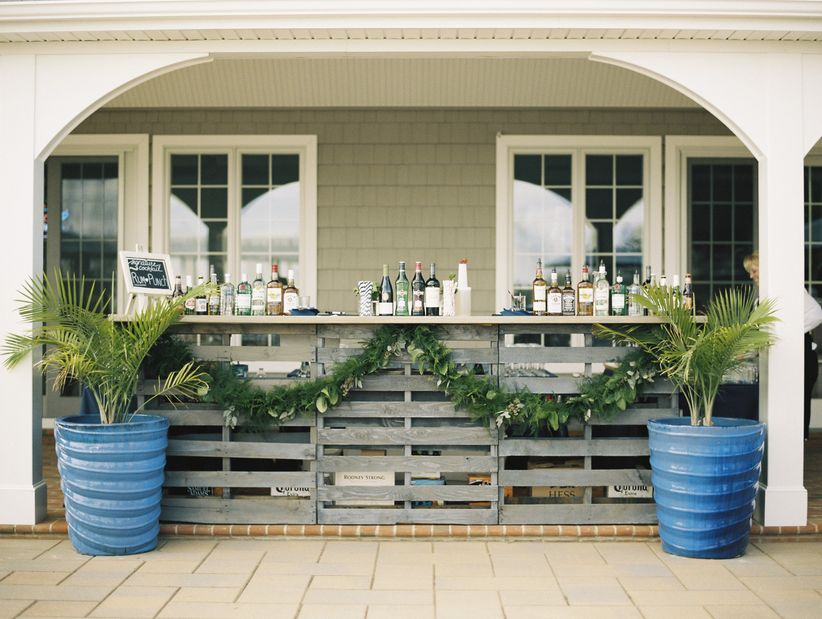 wedding bar decorated with greenery