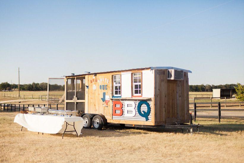 bbq food truck in a field
