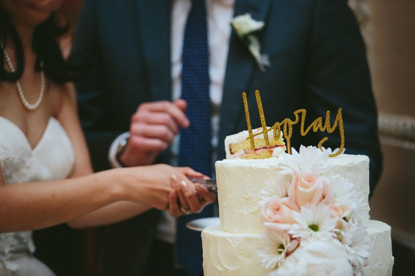 cake cutting with hooray gold topper