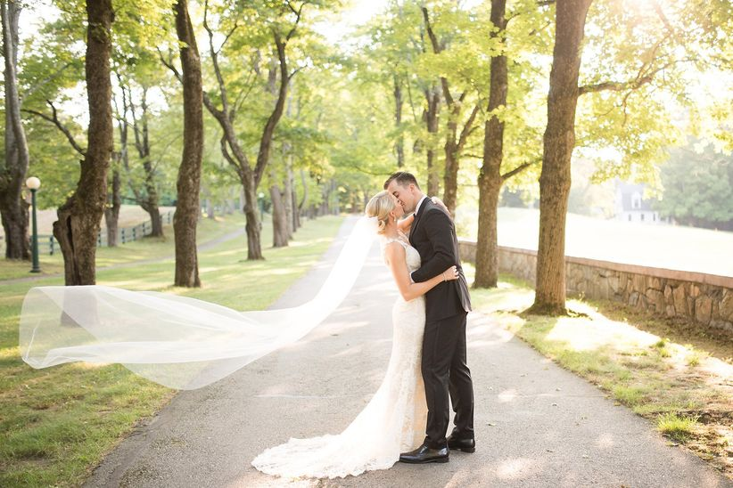couple kissing with bride veil