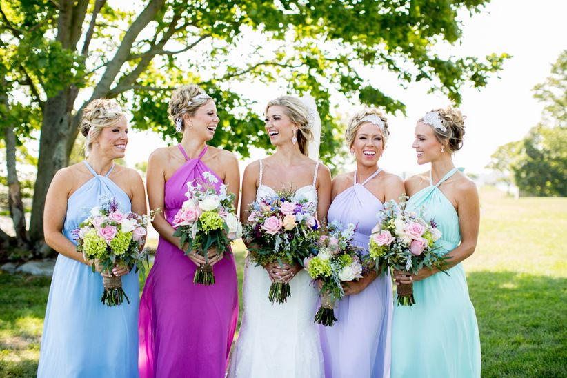 bridesmaids wearing different color dresses